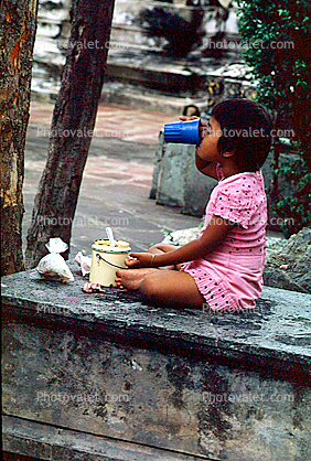 Girl Drinking from Cup, Table