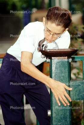 Boy drinking from a Water Fountain, aquatics