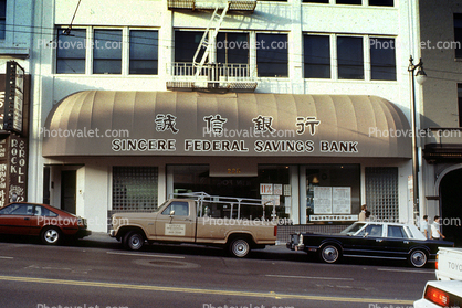 Singers Federal Savings Bank, awning, pick-up truck, cars, building