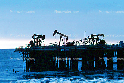 pier, Pumpjack, also known as nodding donkeys, pumping units, horsehead pumps, beam pumps, sucker rod pumps (SRP), grasshopper pumps, thirsty birds and jack pumps