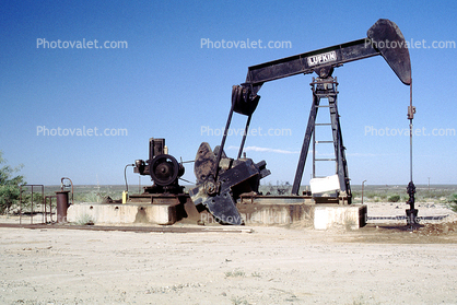 Pumpjack, also known as nodding donkeys, pumping units, horsehead pumps, beam pumps, sucker rod pumps (SRP), grasshopper pumps, thirsty birds and jack pumps, near Las Cruces New Mexico