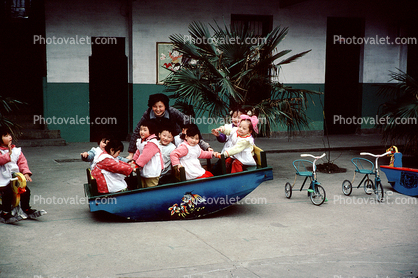 Rocking the boat, Teeter-totter, Tricycle, Girls, Boys, Wuxi, Shiangsi, China, 1950's