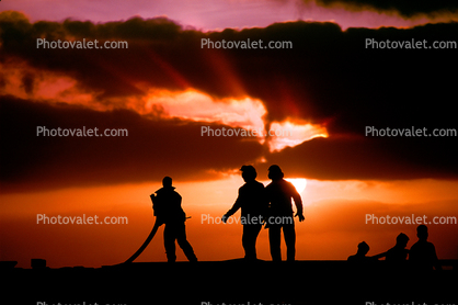 Sailors Moving a Hose, Sunset Clouds