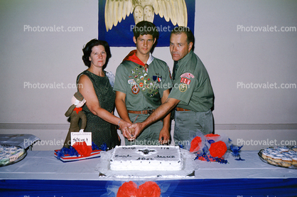 Boy Scout Birthday Cake Cutting Man Woman Mother Father
