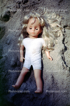 Sleeping Doll in the Sand
