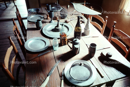 Table, Plates, setting, chairs, knife, wine bottle