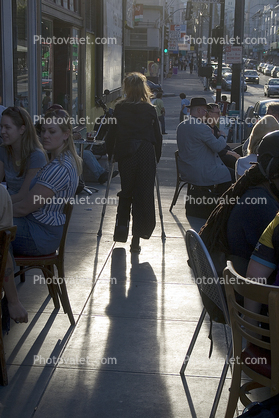 Legless Woman Walking On Crutches Sidewallk Cafe North Beach