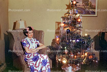 Christmas Tree decorated, decorations, woman sitting, 1940's