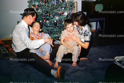 Christmas Tree decorated, decorations, woman sitting, boys, father mother, retro, 1940's