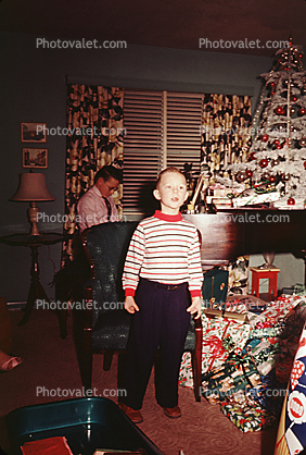 Christmas Tree decorated, decorations, boy, piano, presents, 1950's