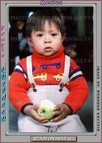 Boy eating an apple, Colonia Flores Magone