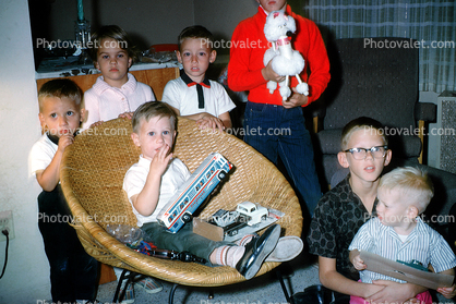 Boys, Chair, bus toy, poodle toy, glasses, 1950s