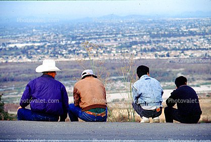 men overlooking the border to the North, Illegal immigrant, Looking north to San Diego, Norte