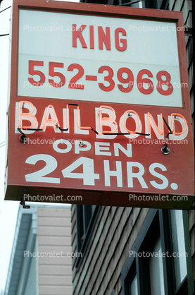 Bail bond, signs, signage, cars, buildings