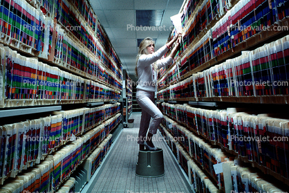 Records Hall, Record Keeping, Files, Woman, Retrieval, Hall, Racks, Folders, File Folders, Paper Rows, paperwork, bureaucracy, archive, clutter, documents, dossier, workers, vanishing point, 1980's