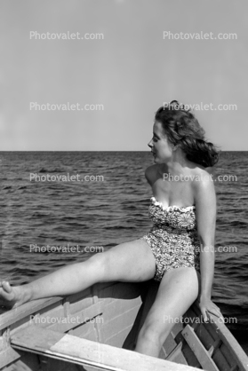 Woman on a rowboat, swimsuit, swimwear, 1940's