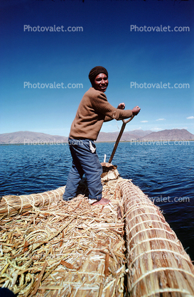 Man, smiles, water, mountains, Reed Boat, Totora Reeds, Lake Titicaca