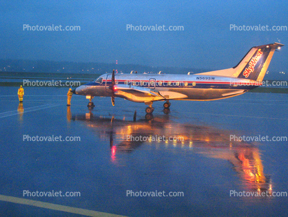 N569SW, Reflection on a Rainy evening in Portland, Embraer EMB-120ER