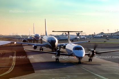 Aircraft lined up for take-off, American Airlines AAL, Boeing 737, Embraer Brasilia EMB-120