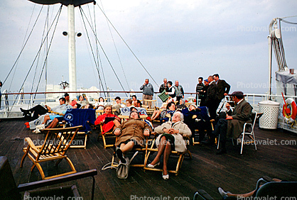 Relaxing on Deck, Fur Coats, sleeping, women, deck chairs, cold, 1950's