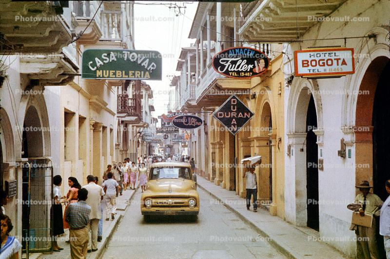Casa Tovar, Cartagena, downtown, cars, buildings, city, shops, store signs, Ford Pickup Truck, 1950's