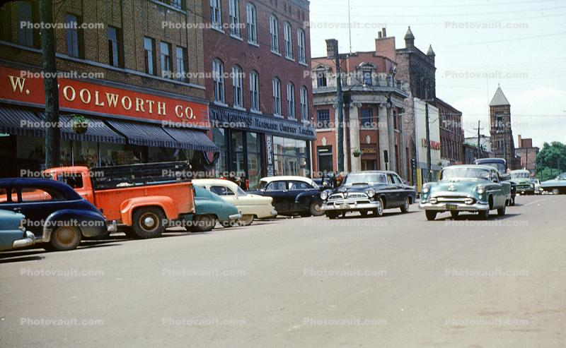 Cars, stores, FW Woolworth, Downtown Charlottetown, Prince Edward Island, PEI, July 1957, 1950s