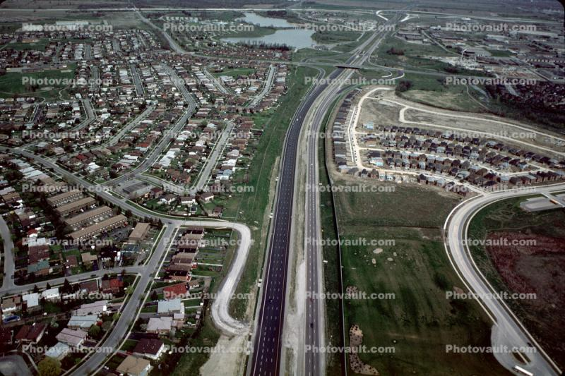Highway, homes, houses, streets, suburban, suburbia, canal
