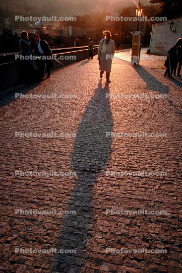 Person Walking, shadow, cobblestone street, Sunset, Sunclipse