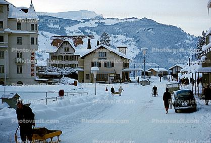 Street Scene, Sled, Cars, Homes, Buildings, Grindelwald, Switzerland, 1950s
