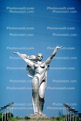 Female Steel Monument, sculpture, memorial, outstretched arms, woman, robe