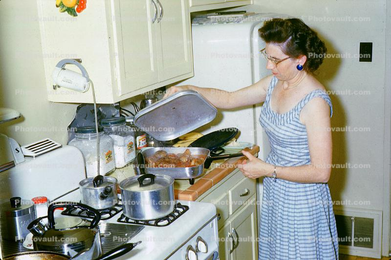 Woman Cooking in the Kitchen, Meat, Gas Stove, frying pan, egg beater, May 1960, 1960s
