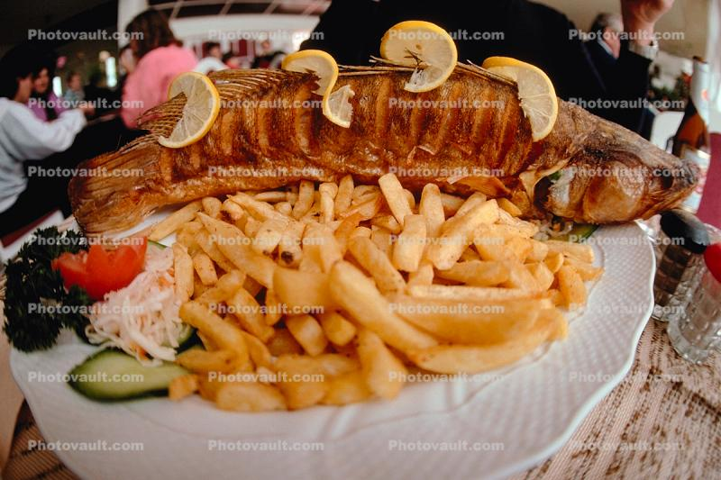 french fries, fish, plate, lemons, pickle, cooked food, deep-fried