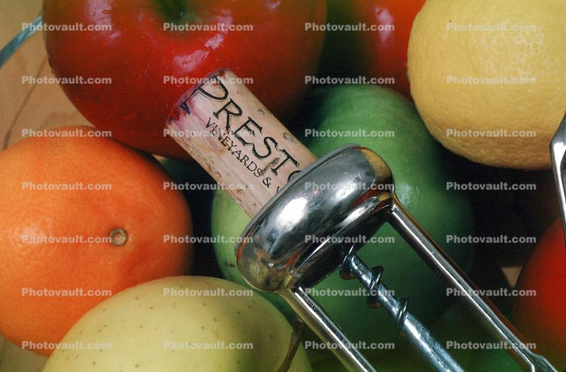 Corkscrew, corker, apples, lemon, bottle opener, cork