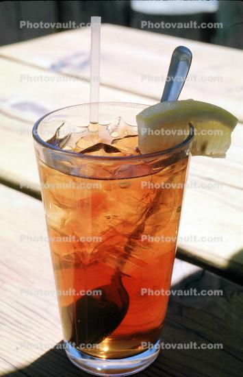 Iced Tea in a Glass, Ice, straw, lemon wedge, spoon, ice, utensil