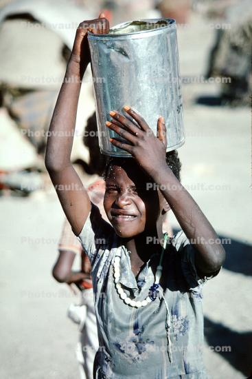 Boy with Water Bucket, Refugee Camp, Somalia