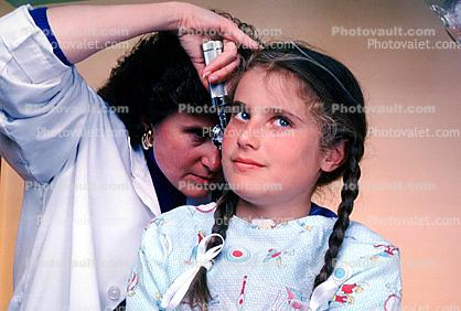 Doctor and girl patient, ear examination, otoscope, ear scope, Female, Woman