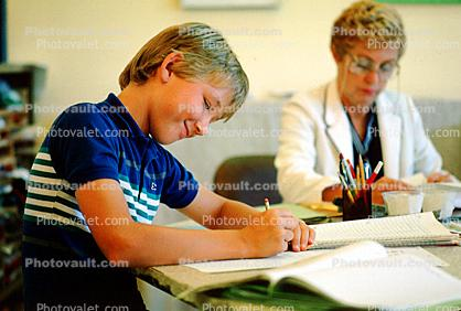 Boy Writing, Classroom, smiles