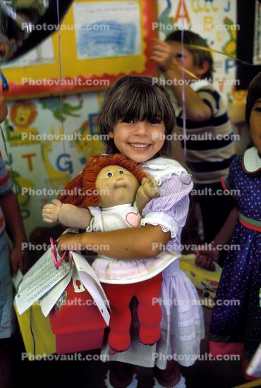 Girl, Cabbage patch doll, Lunchpail, Smiles, classroom, Raggedy Ann, Student