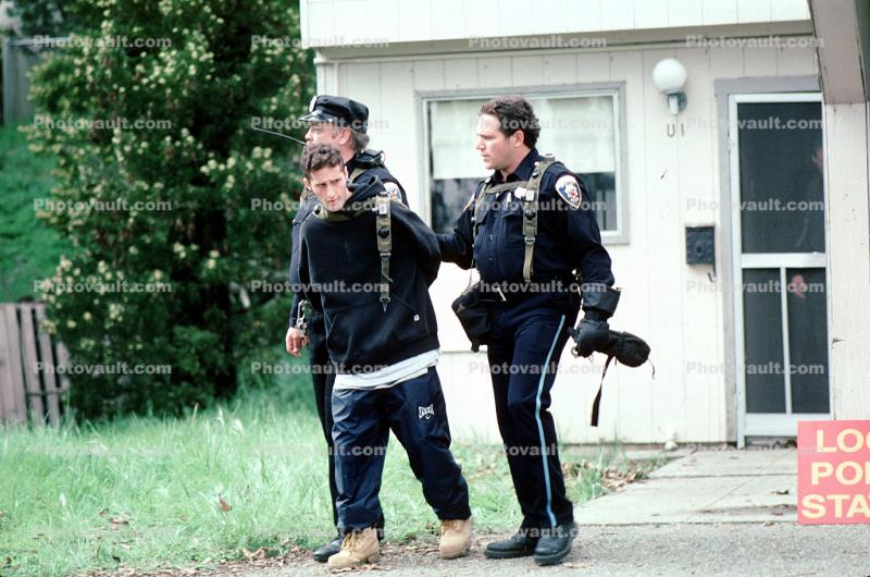 Police arrest a boy, handcuffed, Policeman, Operation Kernel Blitz, urban warfare training