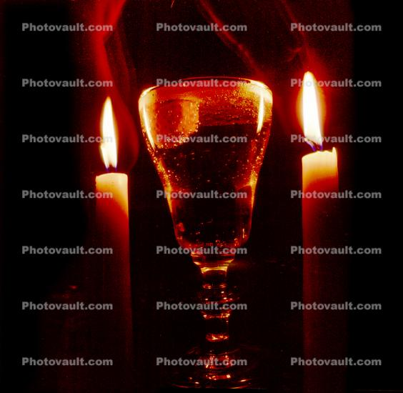 two candles and a glass