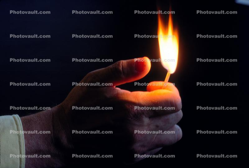 thumb strikes a flame, self striking match