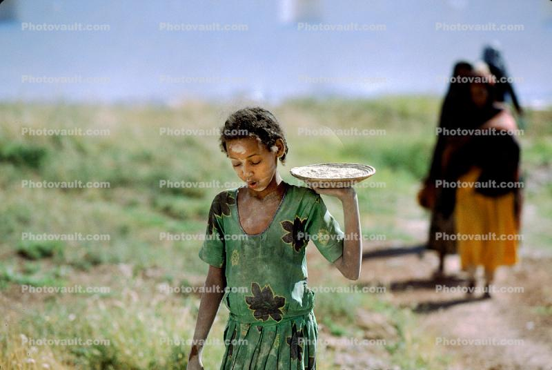 Girl Carries a Plate with Food, Dress