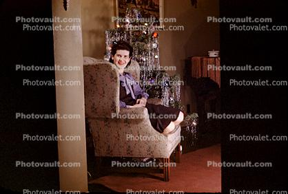 Woman, tree, chair, decorations, tinsel, 1940s