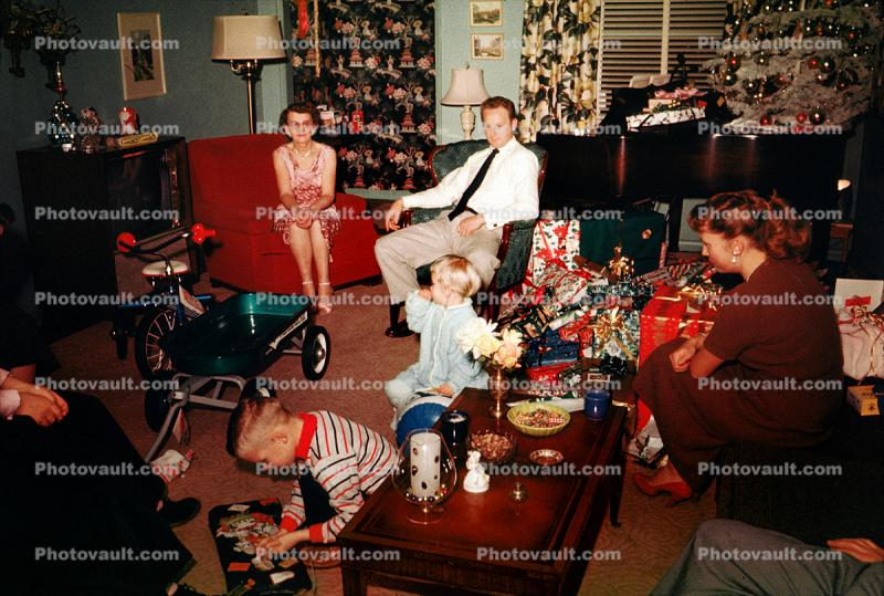 Christmas Tree decorated, boy, girl, father, mother, pony tail, tricycle, piano, presents, 1950s
