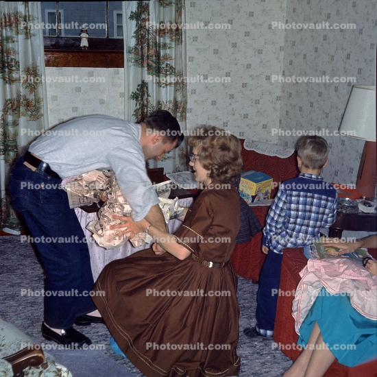Unwrapping Presents, Woman, Dress, Man, Jeans, 1950s