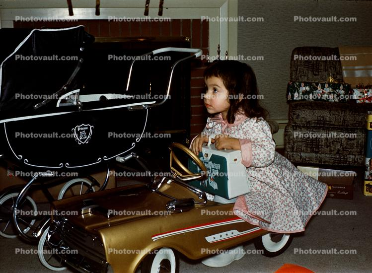 Girl with her Golden Pedal Car, toy, 1950s