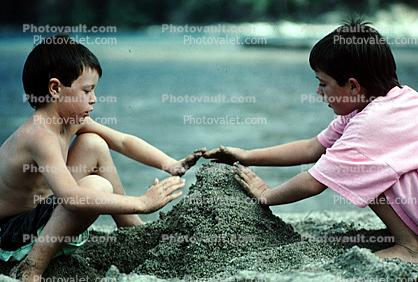 boys building a sandcastle