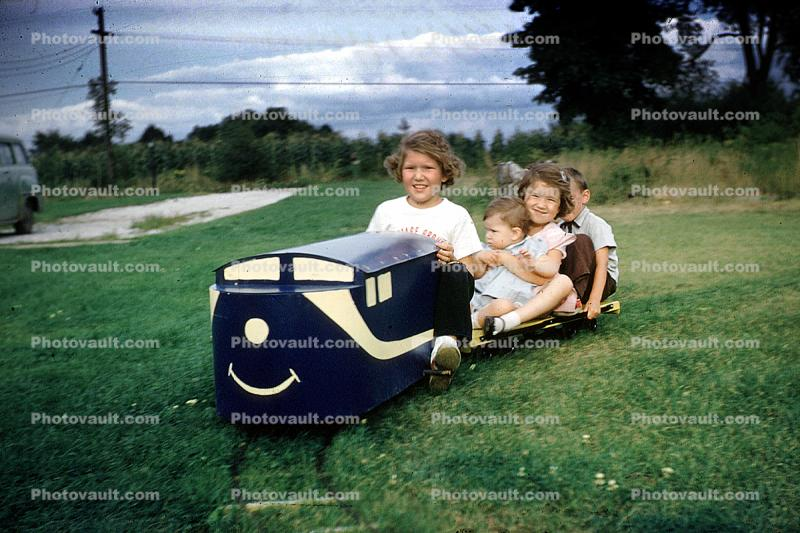 backyard train, Girls, Boys, Smiles, Miniature Train, Riding, smiling, cute, flat car, Akron Ohio, 1950s