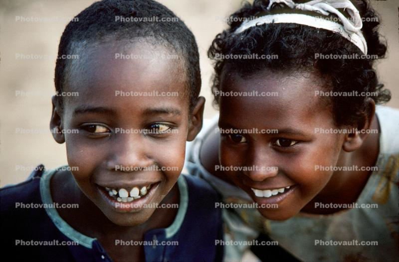 Two Smiling Friends Gazing to the Side, Somalia