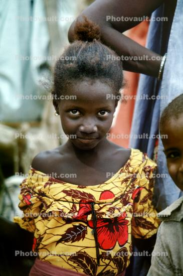 Girl with a smile, eyes, flowery shirt, Dori Burkino Faso, the Sahil desert